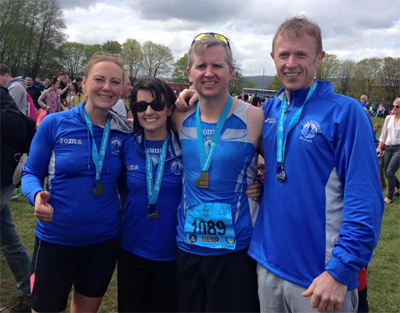 Kate, Marcy, Stephen and Dale all Smiles at the Finish